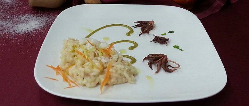 Risotto ai crostacei lime e burrata su crema di asparagi